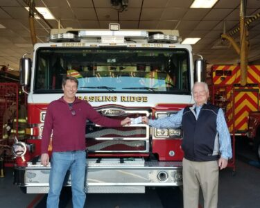 Grand Knight Peter Rovtar making donation to Basking Ridge Fire Departmnet